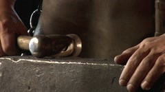 Mysterious blacksmith forges a stem. Stock Footage