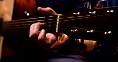 Playing acoustic guitar 3 Stock Footage