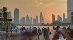 Sunset at the Dancing fountains downtown and in a man-made lake in Dubai, UAE Stock Footage