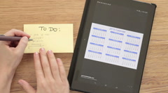 "Woman planning ""To do"" list with digital tablet calendar, top view HD Stock Footage"