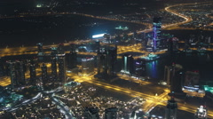 Dubai downtown night scene with city lights from Burj Khalifa timelapse Stock Footage