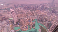 Dubai downtown from day to night transition with city lights from Burj Khalifa - stock footage