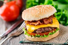 Bacon burger with beef cutlet - stock photo