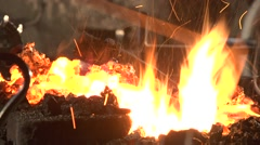 Blacksmith adjusts the bonfire. Stock Footage