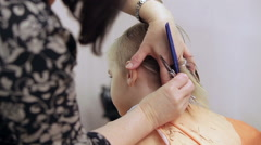 Boy at hairdressers salon. Stock Footage