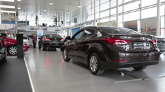 Hyundai Elantra car stands in auto dealership showroom.  Stock Footage