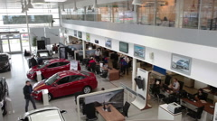 Top view of auto dealership showroom with sale cars. - stock footage