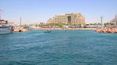Moving boat shot of the entrance to the marina of Eilat Stock Footage