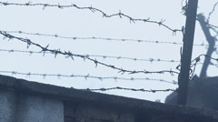 Prison fence with barbed wire 4 - stock footage