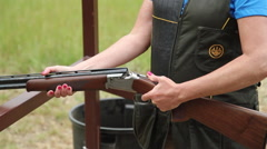 Shotgun shells ejecting wide 2 - stock footage
