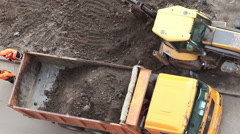 Construction machinery are on landscaping works of extension of parking area Stock Footage