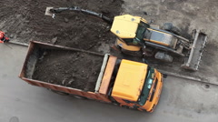 Construction machinery are on municipal improvement of parking area of apartment Stock Footage