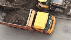 Excavator and heavy truck are on municipal improvement  of inner yard of house Stock Footage