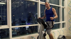 Portrait of happy man exercising on elliptical machine in the gym HD Stock Footage