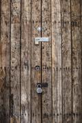 Close up of padlocks on secure door Stock Photos
