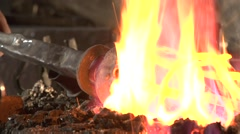 Mysterious blacksmith forges a torch. Stock Footage