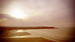 Time-lapse of a bay in evening . Old movie, sepia tones, scratches, flickering Stock Footage