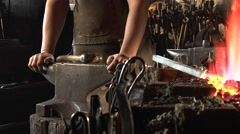 Blacksmith heats a stem in fire, he is preparing for forging. Stock Footage