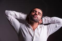 Man stretching and relaxing Stock Photos