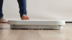 Woman stepping on scales. Full HD 1920X1080P - stock footage
