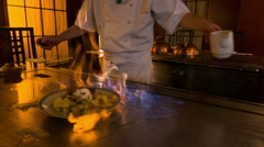 Chef working near big metal hot range in Japanese restaurant Stock Footage