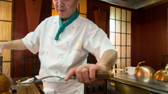 Japanese chef cooking. Tracking shot Stock Footage