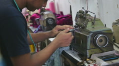 Man fastly working on a sewing machine in workshop in Mumbai, closeup. Stock Footage