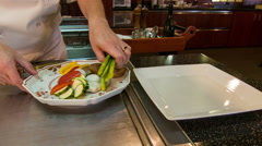 Horizontal dolly shot of chef standing near metal table Stock Footage
