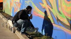 Process Street art people and urban wall graffiti Stock Footage