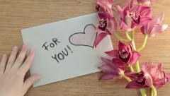 For you note card and flowers on wooden board, top view HD - stock footage