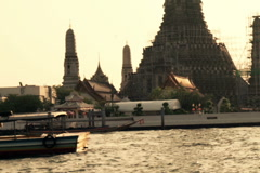 View of Temple of Dawn Wat Arun and boats in Bangkok, Thailand NTSC Stock Footage