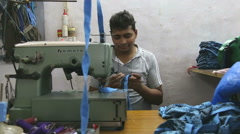 Man arranging a tape by sewing machine in workshop in Mumbai, portrait. Stock Footage