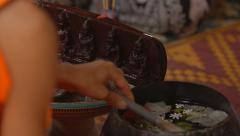 Buddhist monk holding a ceremony, performing the rite - stock footage