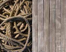 Deck and coiled rope Stock Photos