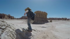Child walking in goblin valley Stock Footage