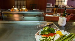 Modern Japanese restaurant bright metal table where chef cooks Stock Footage