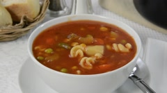 Minestrone Soup and crackers in White Bowl - stock footage