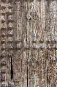 Old studded door - stock photo