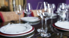 Tracking shot of nicely served table with napkins and glasses Stock Footage