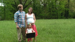 Family pregnancy big sister field Stock Footage