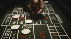 Stock Video Footage of Dice and Chips on Craps Game