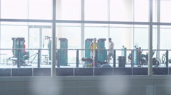 4K Long shot of all male sports team or gym buddies training together in the gym Stock Footage