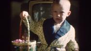 Stock Video Footage of Sweet Baby Boy EASTER EGGs Basket 1960s Vintage Retro Film Home Movie 8205