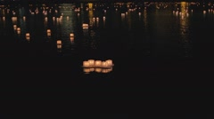 Amazing sight - many lit water lanterns at night Stock Footage