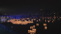 Evening pan - lanterns on water Stock Footage