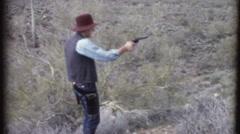 TARGET PRACTICE Man Holding Pistol Gun Shoots 1970s Vintage Film Home Movie 8208 - stock footage