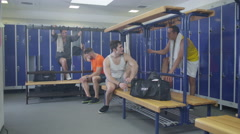 4K Cheerful sports players or gym buddies chatting together in men's locker room Stock Footage