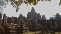 Old Bayon temple of Angkor in Cambodia, ruins, stedicam shot Stock Footage