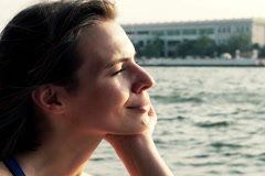 Happy woman riding boat through the river in Bangkok, Thailand  NTSC Stock Footage