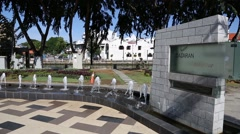 Square with a fountain on the waterfront Malacca River, Malacca, Malaysia Stock Footage